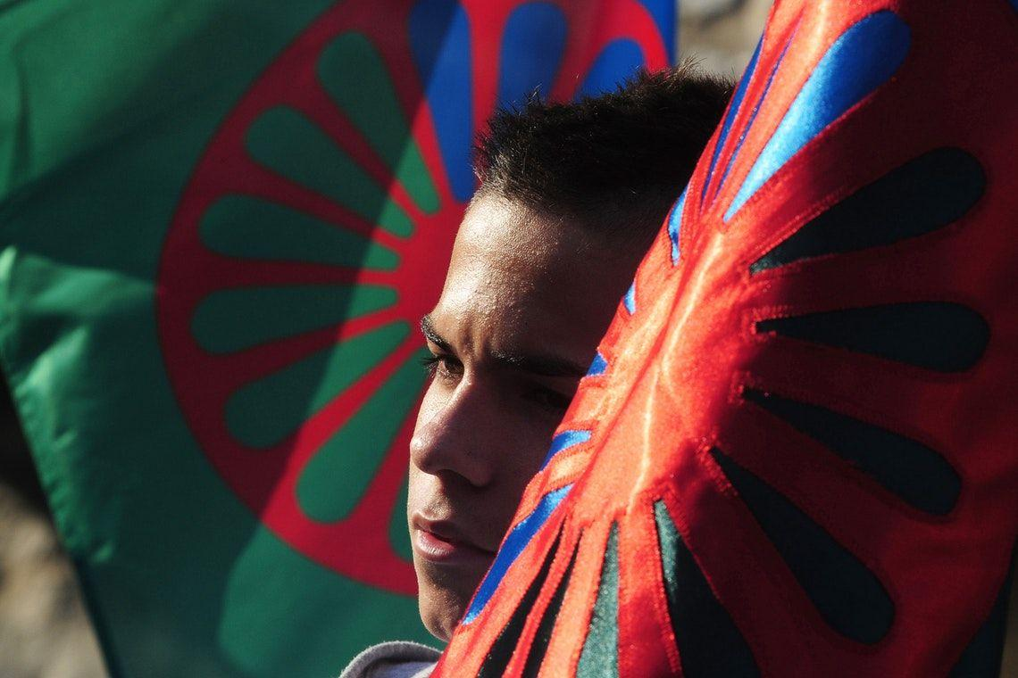 A young boy holds a Roma flag during a demonstration in the northeastern town of Miskolc, Hungary, on October 17, 2012. © Attila Kisbenedek/AFP/Getty